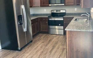 Kitchen with Stainless Steel Appliances and Granite Counters in Collinsville IL